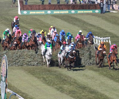 Grand National runners jumping a fence in the Aintree Grand National 2013